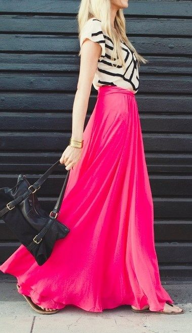 Bright pink skirt with a simple black and white top. The outfit is not too busy