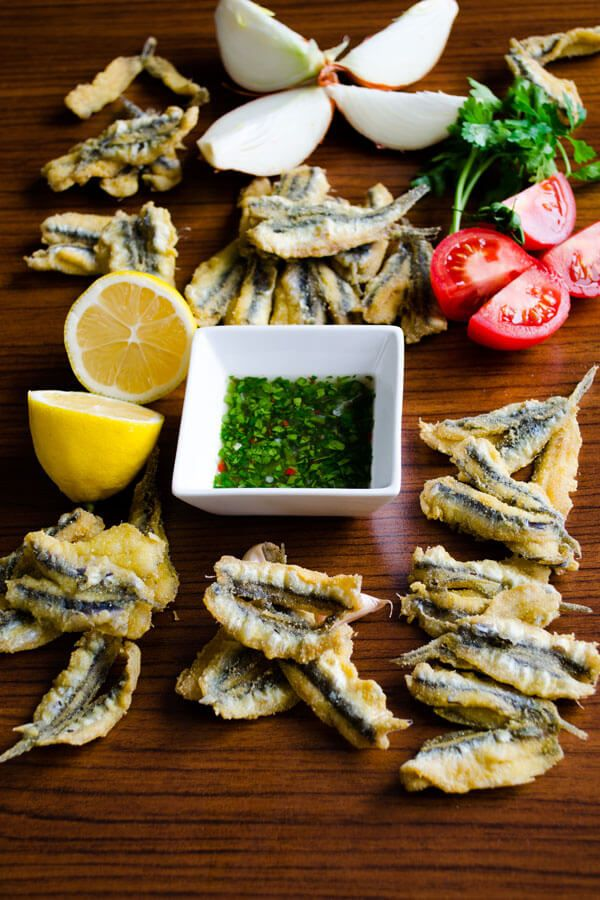 It's not difficult to fry anchovies. You need some corn flour and corn oil for it. Serve fried anchovies with a parsley and lemon sauce.
