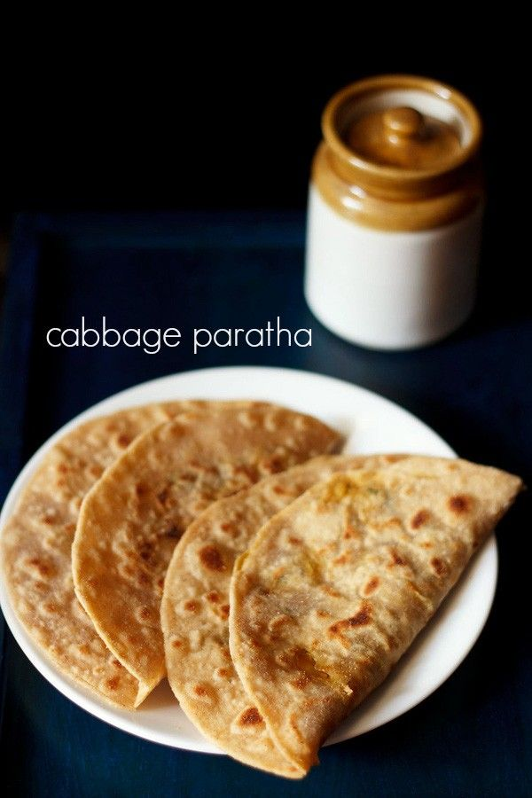 cabbage paratha recipe with step by step photos. whole wheat flat bread stuffed with a spiced cabbage stuffing. there are 2 ways to make cabbage parathas.
