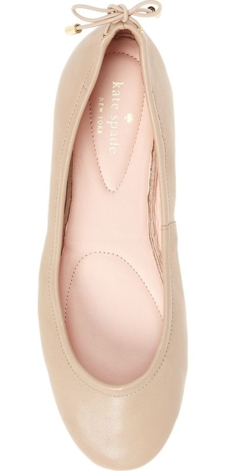 An elastic topline and a rounded toe ensure an effortless fit in this foldable ballet flat by Kate Spade finished with a metal-tipped bow at the heel.