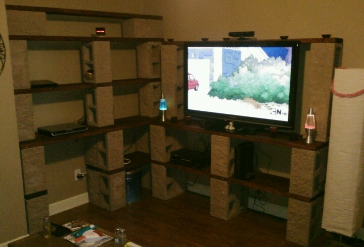 Our home made entertainment center made from cinder blocks and wood that we stained