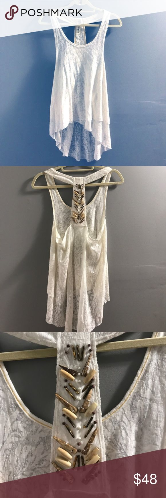 Free People Layered Racerback Top Semi-sheer FP tank so cute with neutral or colored bandeau/bralette. Racerback with simple beading. A true must have! Free People Tops Tank Tops