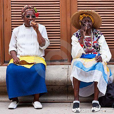 Women in Old Havana smoking cuban cigars by Kmiragaya, via Dreamstime
