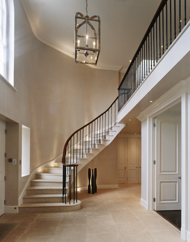 Bill Benette - An elegant entrance hall with lovely staircase to a galleried landing