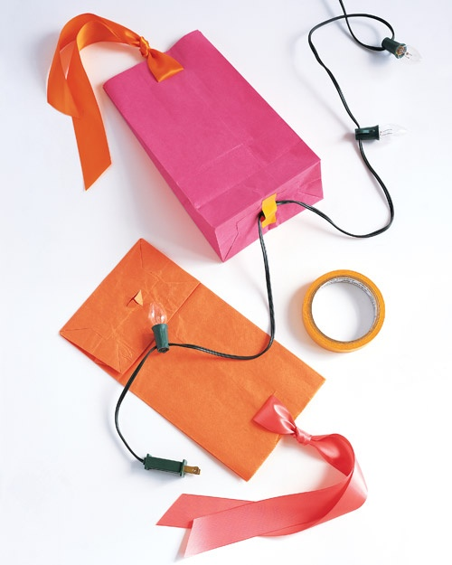 DIY Lanterns - use colorful paper bags, pretty ribbon and a string of outdoor lights to create easy lantern lights for any occasion.