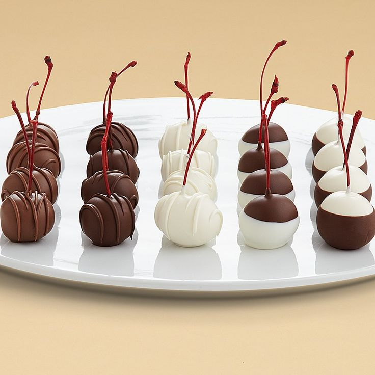 Show that special someone how you feel with the classic gift of hand-dipped cherries. Twenty juicy maraschino cherries are double dipped in dark, milk or white confection, swizzled or dipped one more time to create a gift as beautiful as it is delicious.
