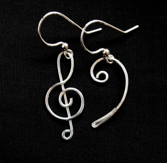 Beautiful treble clef and bass clef motifs are handcrafted from 1/10 sterling silver-filled wire* carefully wrapped and hammered for durability. Dainty earrings dangle approximately 1.25 inches from silver filled french hooks (come with complementary rubber earring backs).    Gift-wrapped as shown in last photo :-) These would be the perfect present for a music teacher, musician, or the music-lover in your life!    *Silver filled wire meets the same legal requirement of gold filled as it...