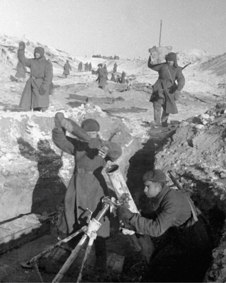 WW2 Red army soldiers reloading a mortar