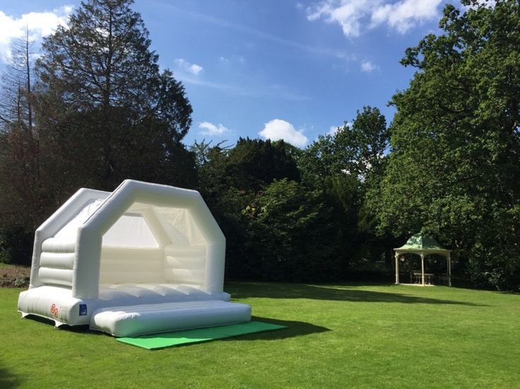Hiring a white #wedding bouncy castle, like this one from All About Fun, is a great way to entertain guests, young and old alike. #Gloucestershire