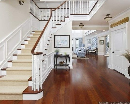 Good example of cherry floors, white accents, white/cherry stairs