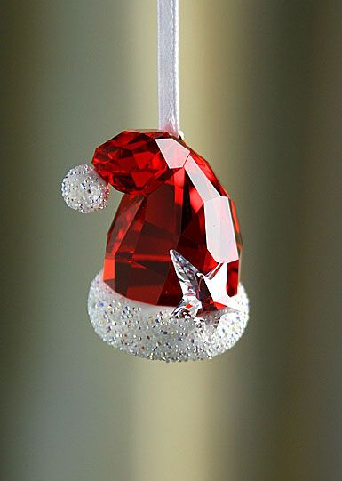 Swarovski - i have this!!! love it!!! bought it in Finland a few years ago during a trip to see santa...how lucky am I?!