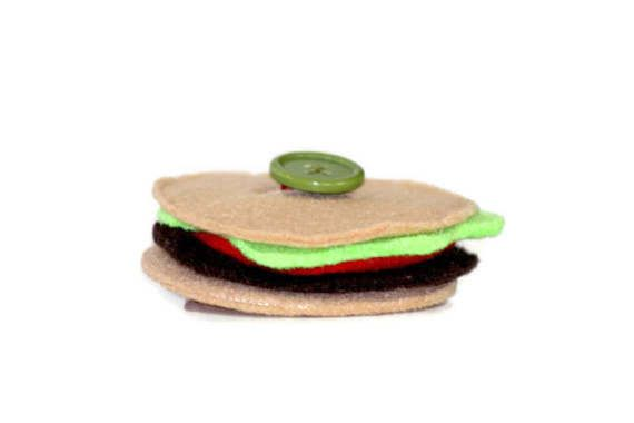 This Hamburger Felt Button Snake is perfect to help your child learn dressing and buttons skills! Work together or have your child build the hamburger independently.   Place the burger pieces onto the ribbon in the correct order to make a delicious looking play hamburger for all your pretend picnics and BBQs!