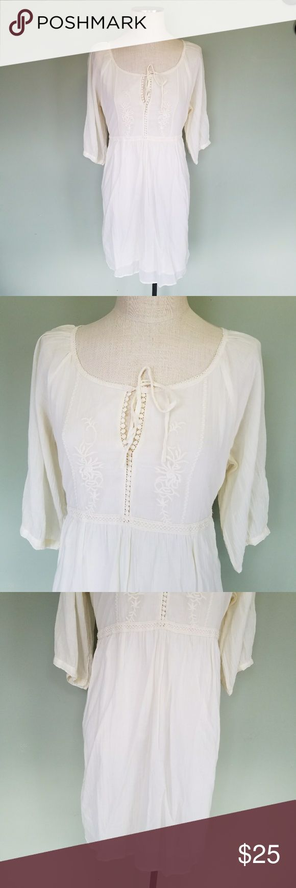 """Old Navy Embroidered Peasant Dress Old Navy.  Women's XL. Peasant Boho Dress. Color: Off-white. Floral embroidery top with lace trim and tied neckline. 3/4 length sleeves. Pleated knee length skirt.  Tie back waist.  100% Cotton. Fully lined.  Excellent condition!  Bust-20.75"""" Waist- 19"""" Length- 38.5"""" Old Navy Dresses"""
