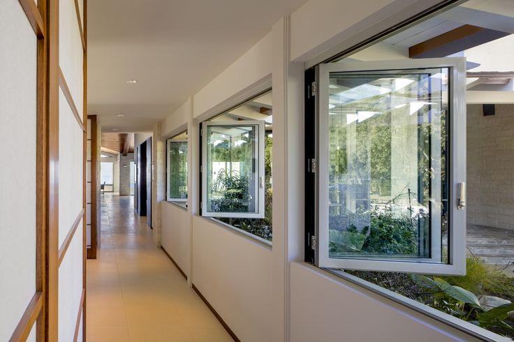 Contemporary Hallway with Shoji door, sandstone tile floors, NanaWall Custom SL60 Folding Glass Wall System