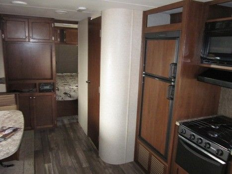 2016 New Heartland TRAIL RUNNER 25RL Travel Trailer in North Carolina NC.Recreational Vehicle, rv, 2016 TRAIL RUNNER by HEARTLAND, 25RL. 29 feet long sleeps 6, electric awning, led lights, electric tongue jack, electric stabilizer jacks,.See this one and many other floor plans at DIXIE CAMPER SALES.