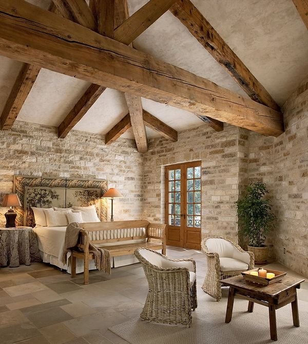 Stone walls with reclaimed timber ceiling; stucco finish