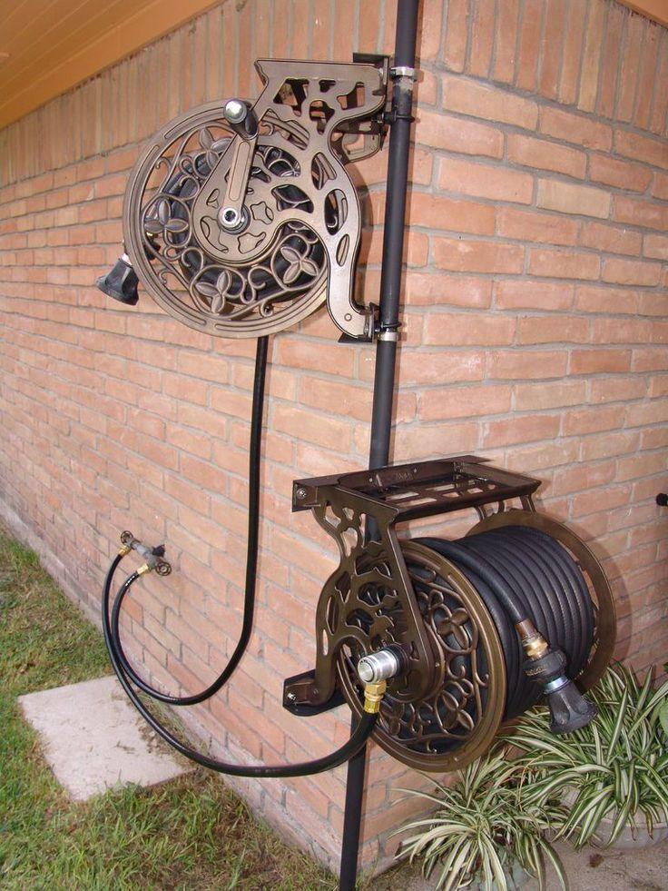 Garden Hose Storage Ideas 17 best 1000 images about garden hose storage on pinterest costco Dual Swiveling Pole Mounted Garden Hose Reels