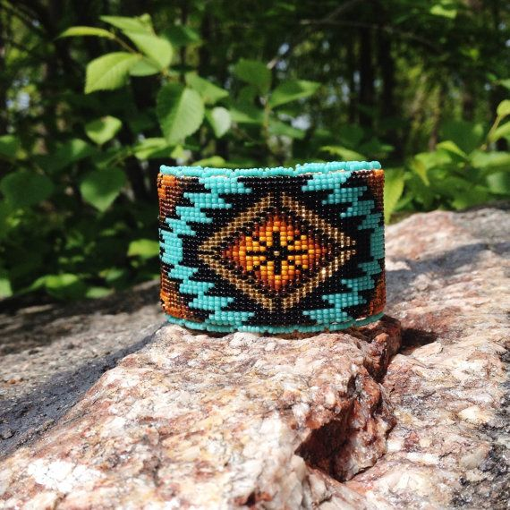 This bracelet measures 1 3/4 inches wide and is 6.5 inches long. The colors are a turquoise with shades of brown and tan contrasted by a matte