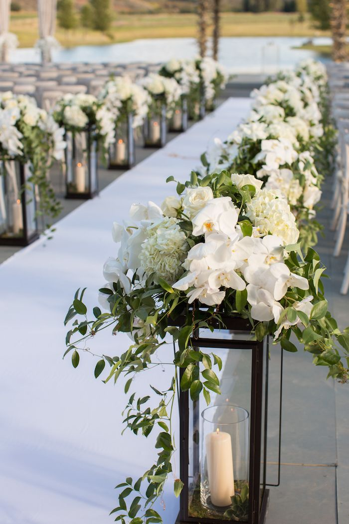 Lantern Aisle Markers with White Flowers | Photography: Perez Photography. Read More:  http://www.insideweddings.com/weddings/incredible-tented-ceremony-barn-reception-at-ranch-in-aspen/860/