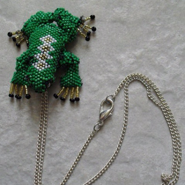 My first rubber frog covered in beadwoven seed beads. It is woven in Peyote stitch and it has a sterling silver plated chain with a sterling silver plated clasp.
