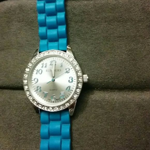 Ladies Rumours watch Watch needs battery. Slightly worn. Great watch and comfortable. See second pic. Jewelry