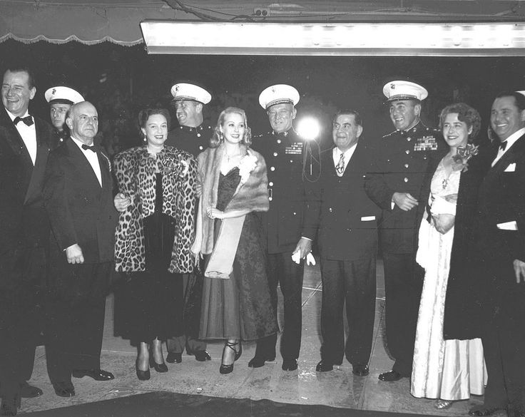 Actor John Wayne, Major General Graves Erskine, and others at the premier of the film Sands of Iwo Jima, 14 Dec 1949