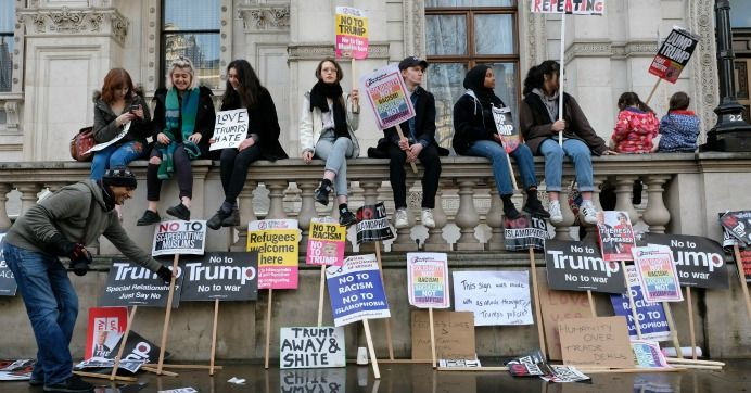 President Donald Trump and Britain's Prime Minister Theresa May have pushed back his official state visit to the United Kingdom to allow the real estate mogul to dodge protests over his administration's right-wing policies, new reporting reveals.