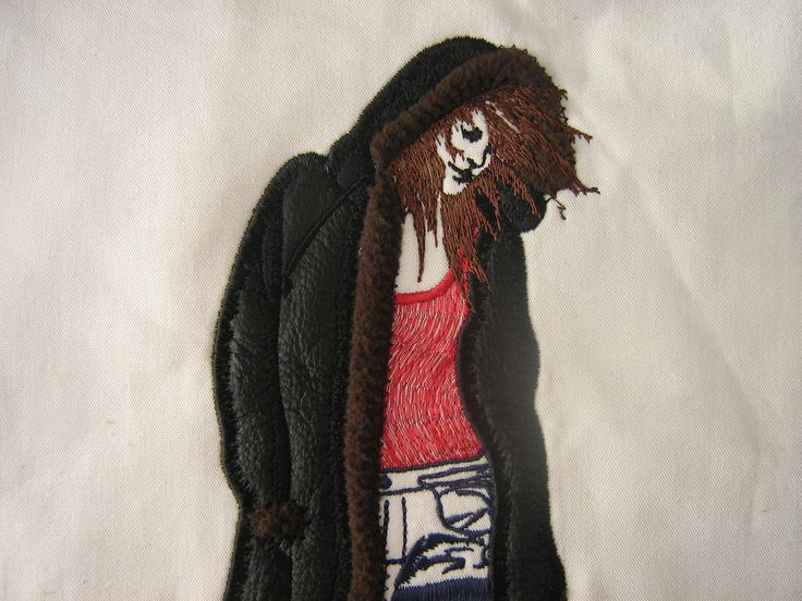 special effects embroidery using applique with leather for woman's jacket and fleece for her fur trim on the hood. #embroidery #leather #applique get your embroidery done today www.kapinua.co.nz