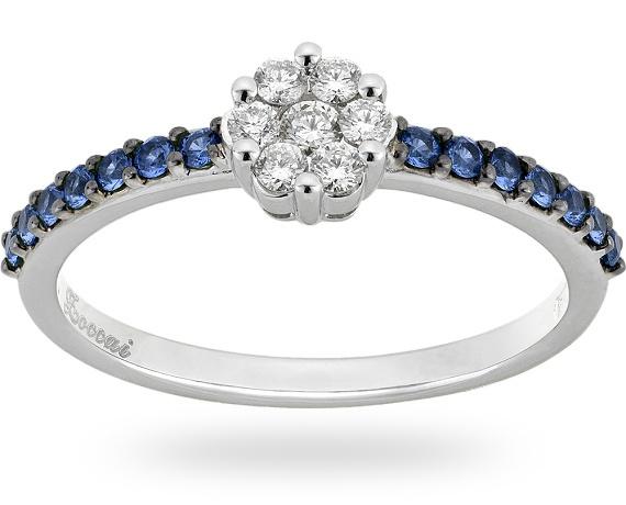 Anello in oro bianco/nero 18 kt. con 0.25 ct. di zaffiro blu e 0.18 ct. di diamante.