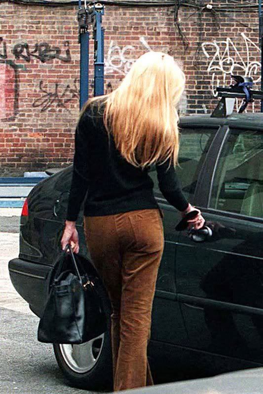 Carolyn Bessette Kennedy in brown corduroys, a black turtleneck, and a Birkin.