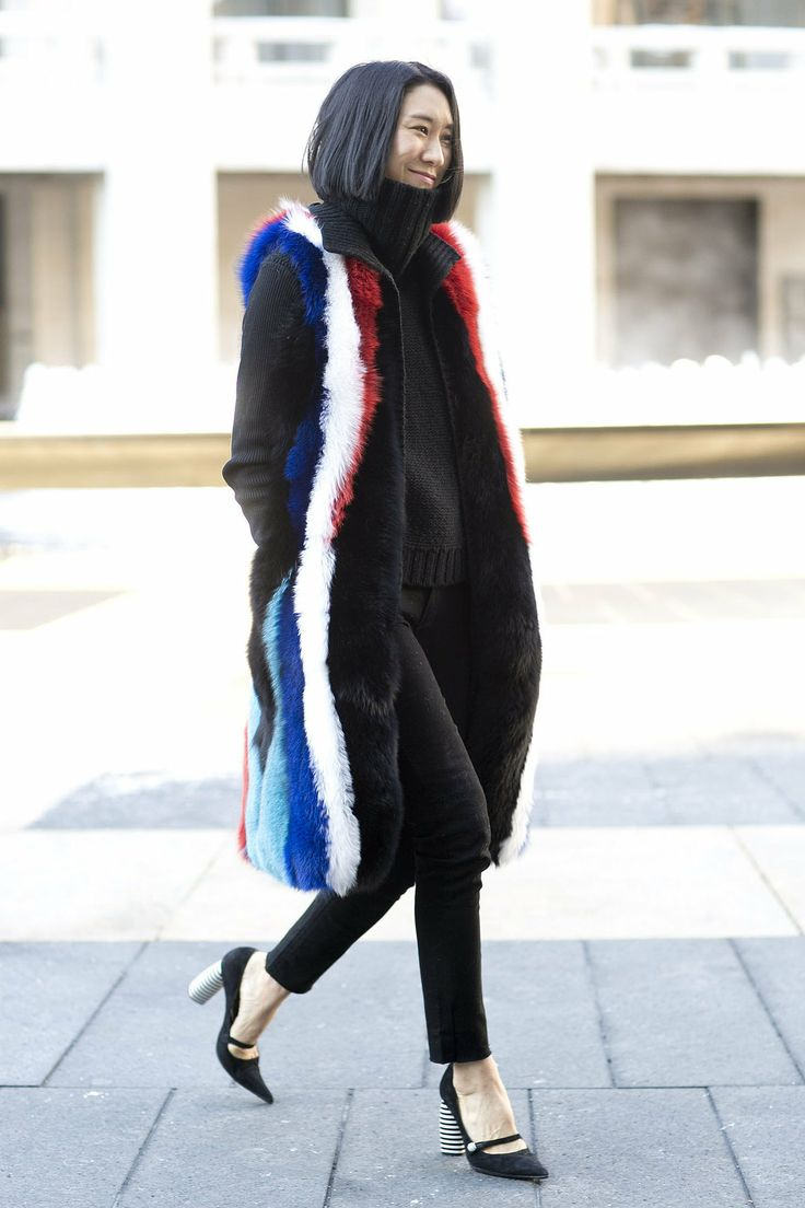 We have outfit envy thanks to Eva Chen's multicolored vest. Street Style New York Fashion Week 2014 #NYFW