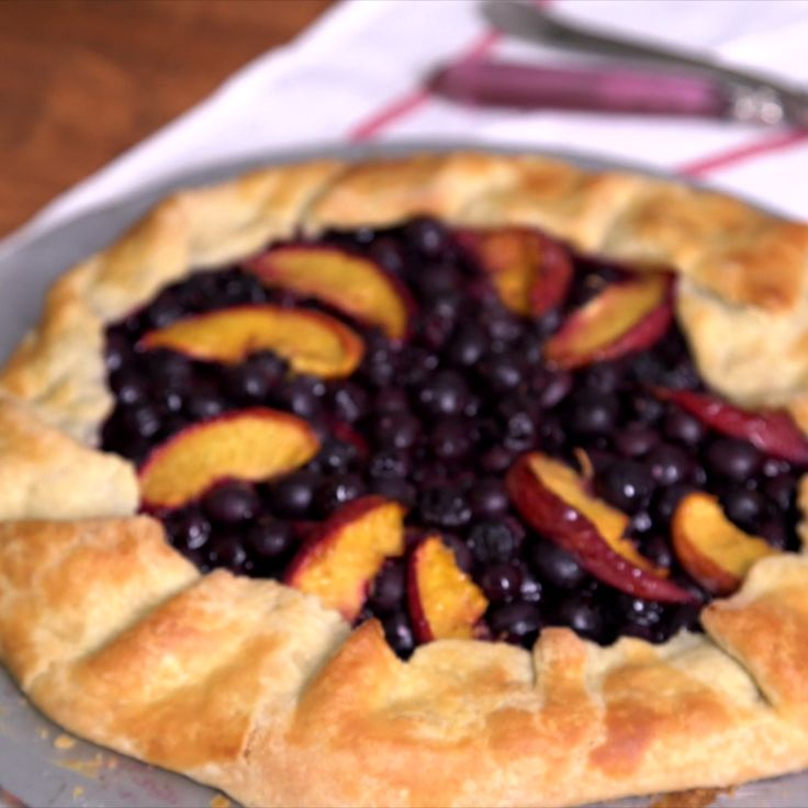 Blueberries and peaches are the perfect bffs in this rustic af galette.