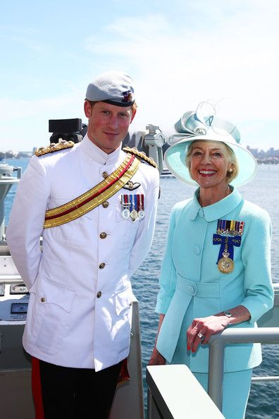 (L-R) Prince Harry and Governor-General Quentin Bryce pose onboard the HMAS Leeuwin as they participate in the 2013 International Fleet Review on 05.10.13 in Sydney, Australia.