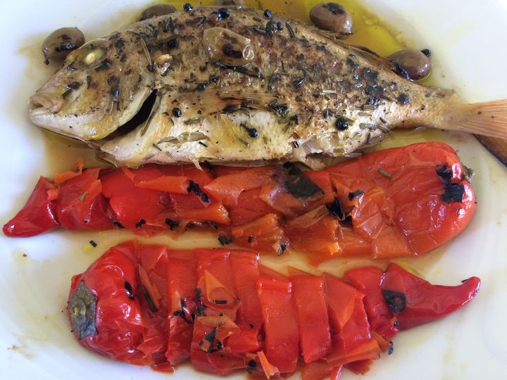 Roasted snapper fish with red peppers and green olives