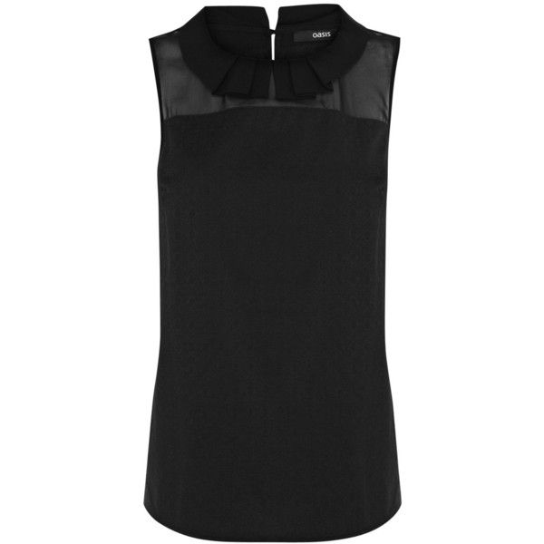 See this and similar Oasis tops - Elegant and sleek, this timeless structured top features a jacquard texture, sheer insert panel at the neckline and a peter pa...