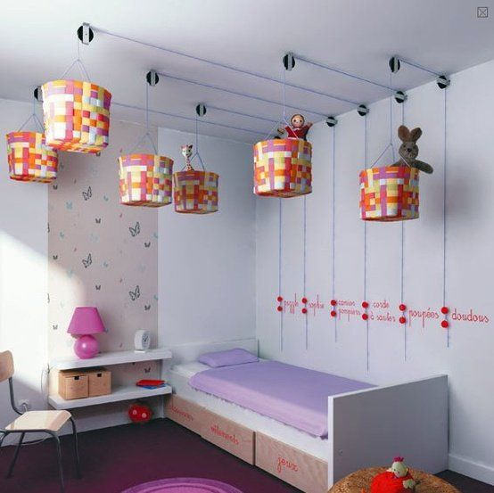 No one ever thinks of utilizing ceiling space for storage. You can actually create a system of hanging baskets on the ceiling that give you loads of storage space and look very neat, too.