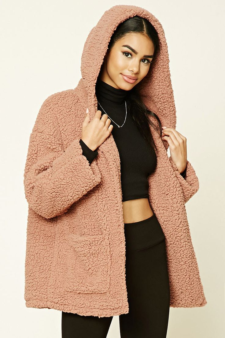 A fleece faux fur jacket featuring a hood, front pockets, an open front, long sleeves, and a boxy silhouette.
