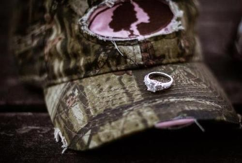 "i usually don't like the ""show off the ring"" pictures, but this idea is so cute, with his hat tho!"