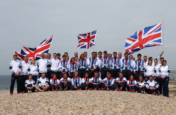 WEYMOUTH, UNITED KINGDOM - AUGUST 11: The Skandia sailing team of Great Britain pose with their winning medals for a photograph at the end of the sailing regatta on Day 15 of the London 2012 Olympic Games at the Weymouth & Portland Venue at Weymouth Harbour on August 11, 2012 in Weymouth, England. (Photo by Richard Langdon/Getty Images)