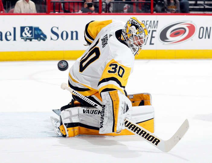 RALEIGH, NC - FEBRUARY 23: Matt Murray #30 of the Pittsburgh Penguins deflects a Carolina Hurricanes shot during an NHL game on February 23 2018 at PNC Arena in Raleigh, North Carolina. (Photo by Karl DeBlaker/NHLI via Getty Images)
