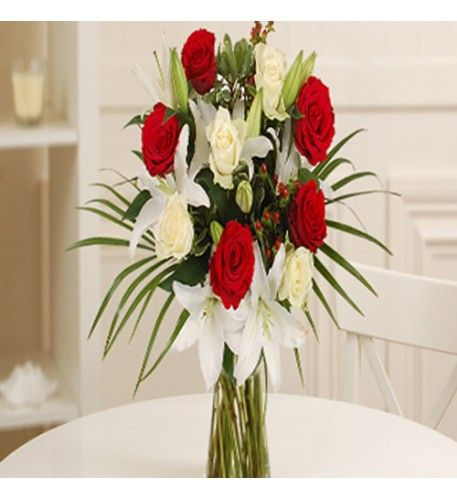 Let your words of love be translated into the language of flowers with this magnificent bouquet which is bursting with white lilies and red and white roses. This red and white colour palette is effortlessly romantic and will represent all the love and passion in your heart.