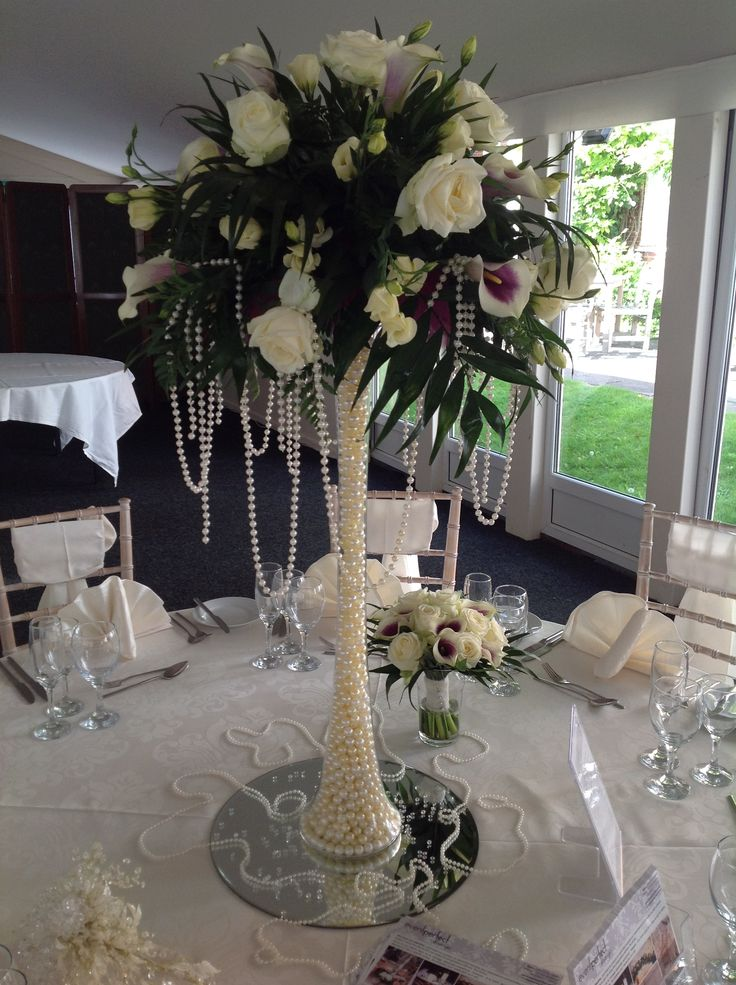 Pearl filled lily vase, complete with floral arrangement on a mirrored base