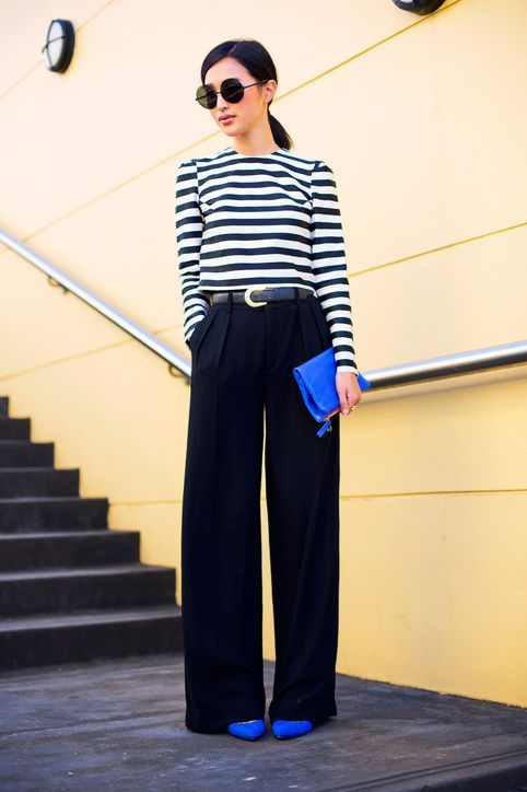 Work outfit ideas that are actually cute for spring and summer. Click to see what we're loving, including looks like this striped top, wide-leg black trousers, and bright cobalt blue accessories from Gary Pepper Girl.