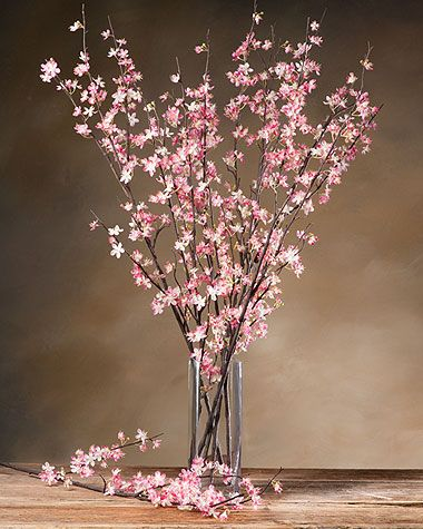 Cherry Blossom Stem ~ Nothing says Spring like our bright and cheerful Cherry Blossom stems. These majestic beauties make a striking display when arranged in a tall vase. Add our glass gems to further enhance the look of your arrangement.