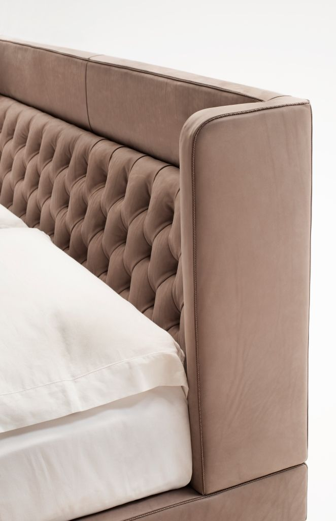 Detail of Living Divani Lipp Bed with capitonné insert in the headboard. Shown here in a luxurious natural and untreated leather with braided leather welt.