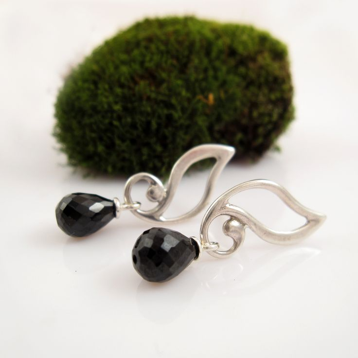Elven Leaves silver earrings with precious gem drops. These earrings delicately outline the shape of a silver leaf, decorated with facet cut purple amethyst, black spinel or soft, white pearls. Its shape elegantly follows the ear lobe, while the pendant below creates life.