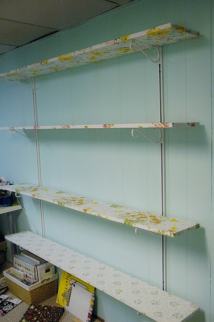 Fabric covered shelves with vintage sheets