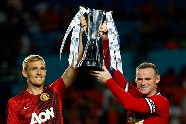 Darren Fletcher #24 of Manchester United and (R) Wayne Rooney #10 of Manchester United lift the trophy following their 3-1  victory over Liverpool in the Guinness International Champions Cup 2014 Final at Sun Life Stadium on August 4, 2014 in Miami Gardens, Florida.