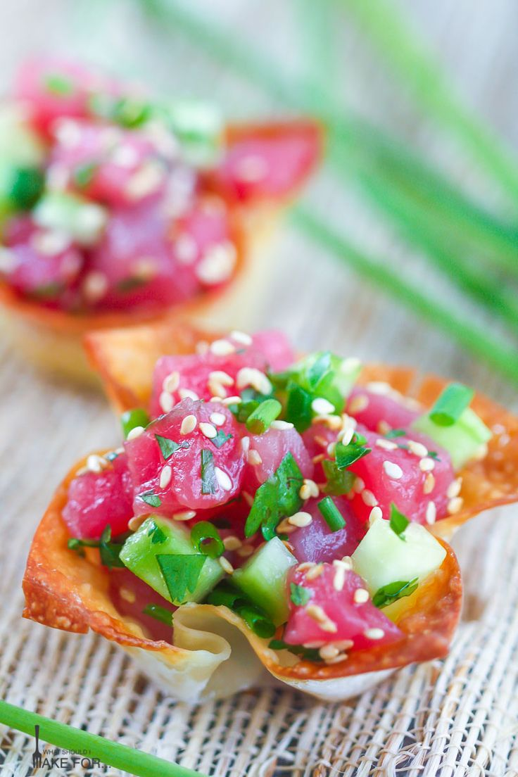 Freshly prepared tuna tartare in crispy wonton cups is a bright and elegant crowd pleasing appetizer.