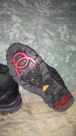 Ботинки с шипами мида